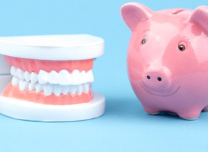 piggy bank and dentures