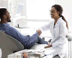 Dentist and patient discussing cost of treating dental emergencies Enfield