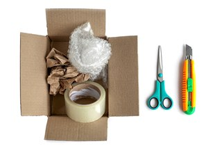 Scissors and box cutter for opening packages instead of teeth