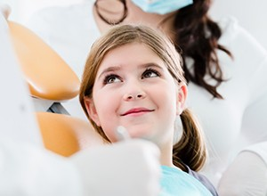 Young girl smiling at dentist
