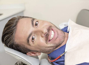 smiling male dental patient