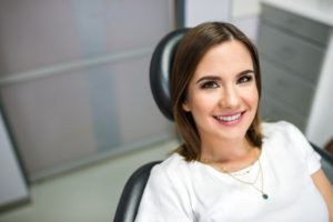 Patient smiling after visiting dentist for dental emergency in Enfield